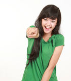 Girl pointing. To the camera isolated on white background Royalty Free Stock Photo