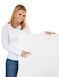 Girl pointing at blank sign. Attractive girl pointing at blank sign. All on white background Stock Photography