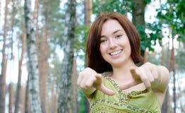 Girl pointing at camera Stock Image