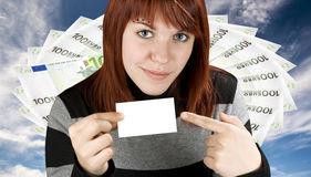 Girl pointing at a card Royalty Free Stock Photo