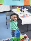 Girl Pointing In Classroom Stock Image