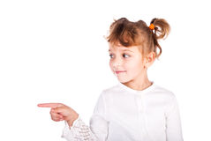 Girl pointing the finger. Isolated on a white background Royalty Free Stock Photo