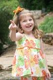 Girl pointing finger. Happy girl pointing finger Stock Photo