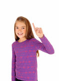 Girl pointing with finger. Royalty Free Stock Photos