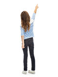 Girl pointing finger at something invisible Royalty Free Stock Photography