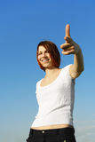 Girl pointing by finger to camera Stock Photography