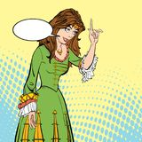 Lady in medieval dress. Medieval legend. Medieval woman. A girl pointing a finger. A woman explaining something. A girl pointing a finger. A woman explaining Royalty Free Stock Photography