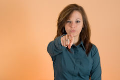 Girl pointing finger at you Stock Image