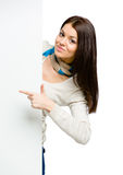 Girl pointing with forefinger at copyspace Stock Photos