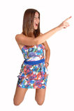 Girl pointing with her finger. Royalty Free Stock Photography