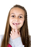 Girl pointing at her missing two front teeth Royalty Free Stock Images