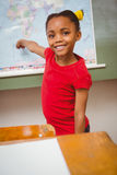 Girl pointing at map in classroom Stock Photos