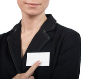 Girl pointing at notecard. The girl specifies in the card on a white background Royalty Free Stock Photo