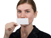 Girl pointing at notecard. The girl specifies in the card on a white background Royalty Free Stock Photos