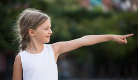 Girl pointing outdoors Royalty Free Stock Photo