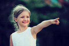 Girl pointing outdoors Royalty Free Stock Image