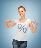 Girl pointing at percent sign Royalty Free Stock Photography