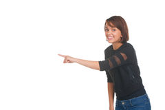 Girl pointing at something and smiling Stock Images