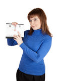 Girl pointing to date in flip calendar Stock Image