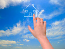 Girl pointing to dream house Stock Image