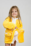 Girl pointing to a hole in the pocket of his robe Stock Photos