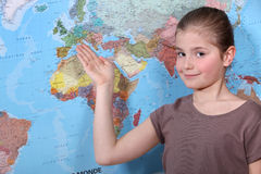 Girl pointing to map Stock Photography