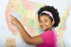 Girl pointing to map. Royalty Free Stock Photos