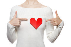 Girl pointing to origami heart Stock Photo