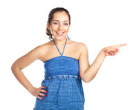 Girl pointing to the side Royalty Free Stock Image