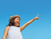 Girl pointing to the sky Royalty Free Stock Photos