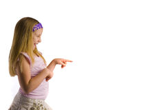 Girl Pointing to White Royalty Free Stock Images