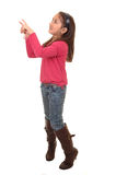 Girl pointing up. Stock Photos