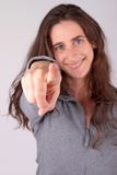 Girl pointing at you Stock Photography