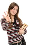 Girl pointing at you with both hands Stock Photography