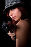 Girl pointong pistol Royalty Free Stock Photography