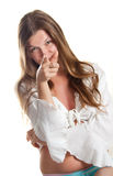 The girl points a finger. Isolated on a white background Stock Photo