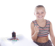 The girl points a finger. On a white background Stock Images