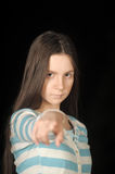 Girl points a finger Stock Photography