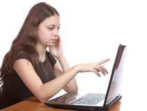 Girl points  finger at the laptop screen Stock Photography