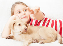 Girl points the finger pup Royalty Free Stock Photos