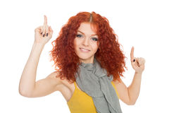 Girl points fingers up Royalty Free Stock Photos
