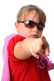 Girl points her finger at camera isolated on white Stock Photo