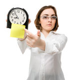Girl points to clock (focus on clock) Stock Image
