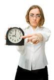 Girl points to clock (focus on clock) Royalty Free Stock Photos