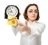 Girl points to clock (focus on clock) Stock Photo