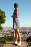 Girl in pois dress watch Paris panorama from Montmartre. At sunset, Paris Royalty Free Stock Images