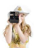 Girl and a polaroid camera Royalty Free Stock Images