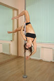 Girl pole dancing in the studio Stock Image
