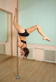 Girl pole dancing in the studio Royalty Free Stock Photo
