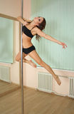 Girl pole dancing in the studio Royalty Free Stock Image